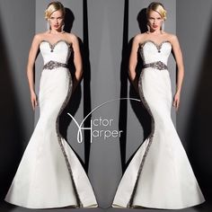 The spectacular and dramatic glamour of #VictorHarper Style: VHC271 Strapless fit and flare gown with black silver & smoke embroidered tuxedo beading belted waist. #victorharpercouture  #bridetobe #bride #bridal #weddinggown #wedding #weddingdress #weddingday #beading #strapless