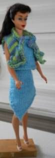 FREE Barbie Knit Pattern, Outfit for fashion dolls: a skirt, sleeveless shell, and ruffled vest from multicolored hand dyed silk yarn.
