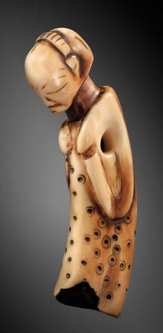Democratic Republic of Congo | 'mikisi mihasi' pendant from the Luba people; ivory.  H: 11.5 cm | 36'250€ ~ sold ('07)