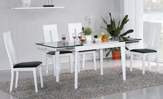 "AtHome DT103 + DC6059W Diningroom Set - This DT6016 dining room table is a simple and functional design, perfect match for a small modern dining place. This DT6016 dining room table has an extend-able wooden body and glass top with a unique and functional combination. Extension to 71''. Also available in shiny white. Size : Dining Table : 42"" / 71"" x  31.5"" x 30"" Chair : L 17.5'' X W 18'' X  H 40''"