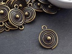 Buy Now Round Bronze Coin Tribal Ball Dot Charms Ethnic Spiral. Coin Pendant, Matte Gold, Ethnic Jewelry, Jewelry Making Supplies, Silver Coins, Spiral, Jewelery, Plating, Charms