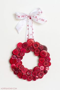 DIY Christmas Red Button Wreath - See more beautiful DIY Chrsitmas Wreath ideas at DIYChristmasDecorations.net!