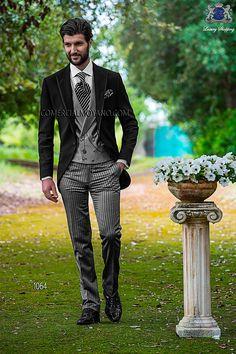 Traje de novio italiano a medida, modelo semilevita en tejido new performance negro coordinado con pantalón raya diplomática moda 1064 Ottavio Nuccio Gala colección Fashion 2015.