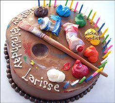 Artist's palette cake decorated with modeling chocolate and buttercream frosting