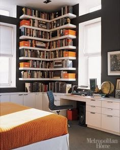I would so love to get rid of his ugly bookcases or do something like this with the orange boxes.