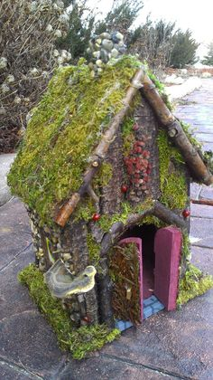 Fairy house handcrafted with forest materials found in Michigan woods.. $134.99, via Etsy.