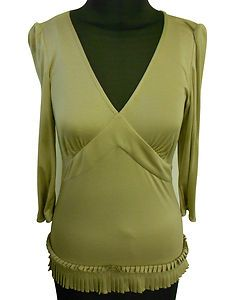 Found on eBay http://www.ebay.co.uk/itm/180964011655  Daks Beige Top,     - Size 10, Long sleeves,  - Pleated detail to hem.     - Soft Jersey    Made in UK.