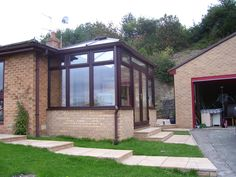 Rosewood PVCu DIY Edwardian Conservatory with Hipped-Back Roof. Manufactured and supplied by ConservatoryLand DIY Conservatories.