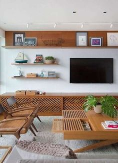 44. Decoração de sala planejada com móveis de madeira e TV na parede sem painel – Foto: Behance Living Room Shelves, Living Room Tv, Small Living Rooms, Home And Living, Kitchen Shelves, Bedroom Decor Lights, Estilo Interior, Living Room Decor Inspiration, Design Your Home