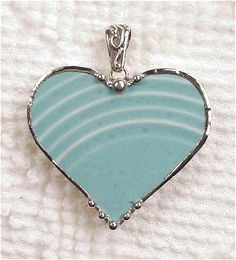 Beautiful pendant made from a turquoise ceramic Fiestaware plate (plates were made from 1938 - 1950)