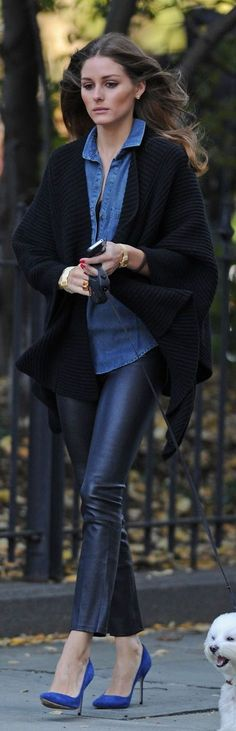 Olivia Palermo pairs a denim button down shirt and cropped leather skinny pants with a chunky, oversized knit cardigan and blue suede point toe pumps.