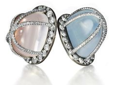 Pair of Moonstone, Quartz and Diamond Ear Clips, by JAR  Each designed as a pavé-set ruby dome, centering upon a cushion-shaped almandine garnet, weighing approximately 7.45 and 7.48 carats, to the diamond-set foliate border, 2001, 3.9 cm, with French assay marks for silver and gold , $93,881.00