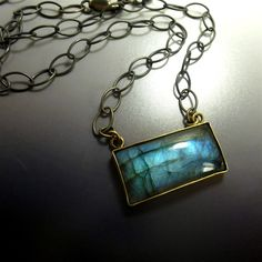 Blue Lagoon Pendant - Sterling silver with 24k gold vermeil and labradorite. Made by Katie Saunders at Oblivion Jewellery