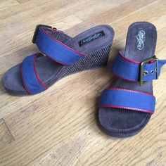 "NWOTSKECHERS Blue Slip-On Wedges NWOTSKECHERS Blue Slip-On Wedges..   Buckle adorned blue canvas/red trim straps.   Cushioned suede fabric footbeds.  3-1/2""'wedge heels. Skechers Shoes Wedges"