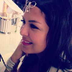 Nona De Samim wearing Modeler bow headpiece and lined cuffs