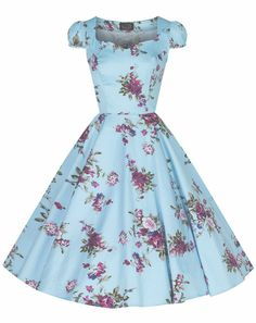 Flaunt your inner pinup with this beautiful tea-length Royal Roses Sky Blue Swing Dress by Hearts and Roses London. The classic sweetheart neckline is demure yet flirty, cap sleeves adorn the shoulders.  The beautiful skul blue cotton fabric features classic colors of lilac, pink, and magenta roses with green leaves.