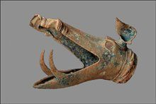 Carnyx (war trumpet). A wind instrument of the Iron Age Celts, c. 200 BCE-200 CE. The bell was styled in the shape of an open-mouthed boar's, or other animal's, head. It was used in warfare, probably to incite troops to battle and intimidate opponents, as Polybius recounts. The instrument's upright carriage allowed it to be heard over the heads of the participants in battles or ceremonies.  it was probably common all over Iron Age Europe