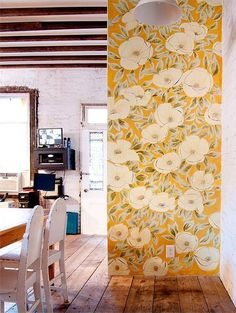 This artist based her floral pattern off a painting, and transferred her inspiration to the wall.   Big bold flowers make the perfect accent wall in this airy, bright space.   Photo:  Design Sponge