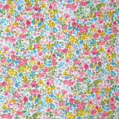 Coton imprimé petites fleurs fond blanc