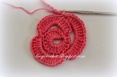 I've seen such roses (but in smaller sizes) used in Irish crochet. The idea is not complicated, and I was able to come up ...