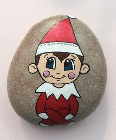 Decorative Rocks : Gorgeous cheeky elf hand painted using acrylic paints onto a . Decorative Rocks : Gorgeous cheeky elf hand painted using acrylic paints onto a pebble. Perfect gift for your elf on the shelf to bring im Regal Ideen Pebble Painting, Pebble Art, Stone Painting, Painted Rocks Craft, Hand Painted Rocks, Stone Crafts, Rock Crafts, Christmas Rock, Christmas Crafts
