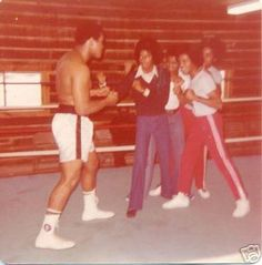 Muhammad Ali and the Jacksons at Ali's training  camp in PA, 1976