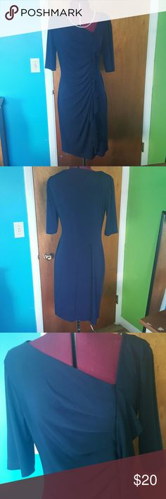 Lovely Navy Dress Lightly form fitting navy dress. Soft fabric, hugs your curves gently, and very flattering. Listed as a 12, fits more like a 10. Worn only a few times, perfect condition. connected apparel Dresses Midi