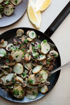 Sunchokes are sautéed with mushrooms and finished with a shower of parsley, garlic and lemon.