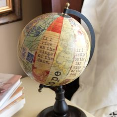 I love old globes fun way to decorate an old beat up one.  You could use scrapbook paper and inspirational quotes.