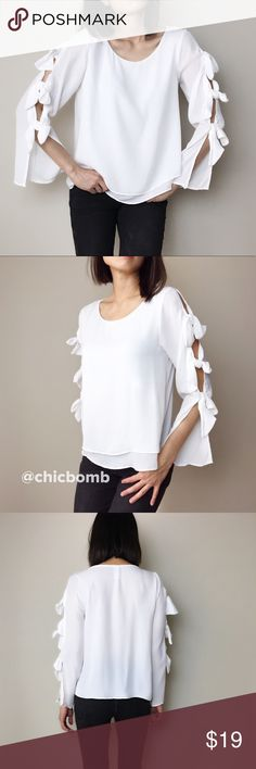 """REbecca ribbon tier top clearance. Flawed This size s has a bit flawed. White long sleeve. Ethereal white blouse with ribbon. Double layer front . Casual chic. Made in USA. 100%polyblend. Size d bust 33"""" .length 23"""". Pictures below shown 2 spot with feign flaw. But almost naked or the eyes. CHICBOMB Tops Blouses"""
