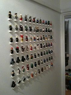 Holy Cow! this is the perfect display for Lego Minifigures! Need to figure out how they did it.....