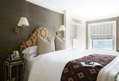 In the master bedroom, Nastasi and Vail imparted a subtle masculine note thanks to the navy-and-brown hues of a grasscloth wall covering.