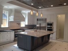 It's #tiletuesday! Celebrate with this stunning kitchen, which features our glossy hex on the floor!