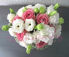 Styled with roses, lisianthus, carnations and ammi majuses.