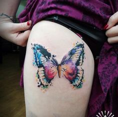 Watercolor butterfly tattoo on thigh by Cynthia Sobraty