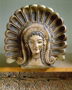 Maenad Antefix. Etruscan. Date: late 6th century BCE Material: terracotta. Measurements: H: 45 cm