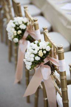Have your bridesmaids' bouquets wrapped in ribbon on their chairs at the head table for a pretty and elegant decor. #wedding #beforetheidos