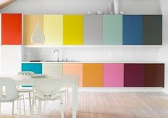 When I have my own home, I am going to go NUTS with decorating. Here's an idea for individually colored cabinets I love. They look like Pantone color chips!