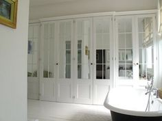 Droooooling over these closet doors.  Wonder if I could do this to mine using thin wood veneers