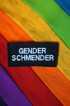 QUEER SLOGANS- Embroidered Patch or Badge– Queer LGBT Identity Accessory- Ask My Pronouns, Queer and Proud  These patches will let everyone know what you think. Stitch, pin, or glue them to anything, and leave no one in any doubt.  Embroidered at my workshop in London, these patches are stitched in your choice of colour onto a black backing fabric- if you'd like a different colour fabric, include a note with your order, and I'll see what I can do- most obvious colours are possible.  If you…