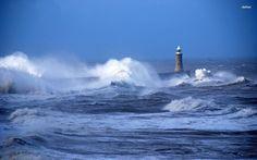 Image from http://cdn.desktopwallpapers4.me/wallpapers/beaches/1920x1200/3/21905-rough-waves-hitting-the-lighthouse-1920x1200-beach-wallpaper.jpg.