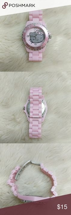 Pink Hello Kitty Watch This pink Hello Kitty watch features a silver encrusted Hello Kitty face. Super cute watch. Just needs new batteries. Some light scratches on the face from normal wear but still in great condition. Hello Kitty Accessories Watches