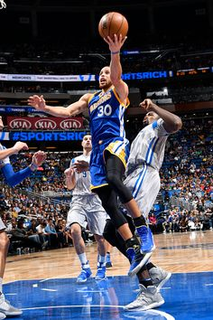 Stephen Curry of the Golden State Warriors goes up for a lay up against the Orlando Magic on January 22 2017 at Amway Center in Orlando Florida NOTE...