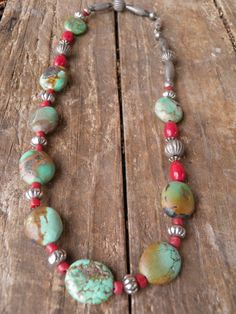 Antiqued fluted round, barrell & rondell silver beads, red clay & glass beads with disk shaped African Turquois beads.