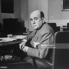 Portrait of Czech Foreign Secretary Jan Masaryk sitting at desk in.