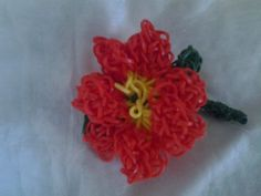 Part 1   POINSETTIA  by Tina Caldwell Wood on Rainbow Loom FB page. Basically, I used the HIBISCUS pattern, however, poinsettias have 10 petals so five petals went on first and the second five only went on a single band. Meaning, that when I attached the first five, I used only a doubled cap band, then placed the other... see more on Pin 2.