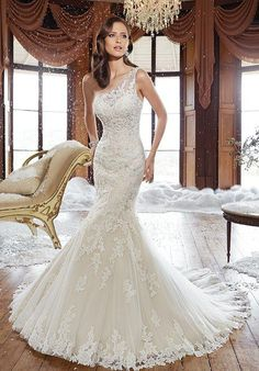 One-shoulder light tulle and lace trumpet gown | Sophia Tolli | https://www.theknot.com/fashion/y21501-rory-sophia-tolli-wedding-dress | https://moncheribridals.com/collections/wedding-dresses/sophia-tolli/?utm_source=theknot.com&utm_medium=referral&utm_campaign=theknot&utm_content=gallery
