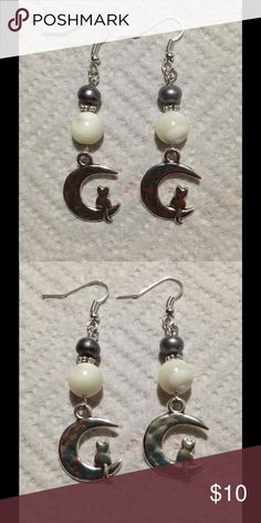 Black White Pearl Cat in the Moon Earrings These lovely earrings are made with mother of pearl and cultured black freshwater pearls. They feature an adorable kitty cat sitting in a crescent moon. The charms are interchangeable; if you'd like different charms let me know. All PeaceFrog jewelry items are made by me! PeaceFrog Jewelry Earrings