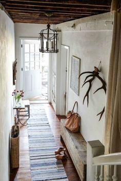 French farmhouse decor and Rustic French Country decor inspiration from a gorgeous European farmhouse style New York apartment styled by Zio + Sons. Plaster walls, antlers, and timeless design ideas. French Farmhouse Decor, Farmhouse Design, Farmhouse Style, Rustic Farmhouse, Rustic French, French Country, Rustic Entry, Farmhouse Bench, Country Style