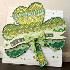 by Paige Evans. LOVE the twine outlining & her use of scalloped patterned papers...